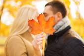 Close up of couple kissing in autumn park — Stock Photo