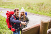 Smiling couple with backpacks hiking — Stock Photo
