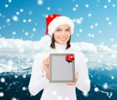Vrouw in helper kerstmuts met tablet pc — Stockfoto