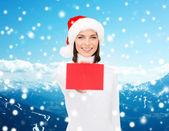 Femme en bonnet d'assistance avec le carton rouge blanc — Photo