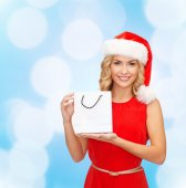 Woman in santa helper hat with shopping bags — Stockfoto