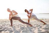 Couple making yoga exercises outdoors — Stock Photo