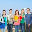 Group of smiling students standing — Stock Photo #53994271
