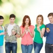Smiling students with smartphones — Stock Photo #53994349