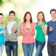 Smiling students with smartphones — Stock Photo #53994405