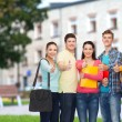 Group of smiling teenagers showing thumbs up — Stock Photo #53995215