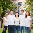 Group of smiling teenagers in white blank t-shirts — Stock Photo #53995989