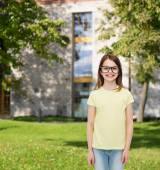 Smiling cute little girl in black eyeglasses — Stock Photo