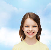Smiling little girl over white background — Stock Photo