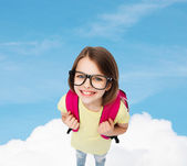 Happy smiling teenage girl in eyeglasses with bag — Stock Photo