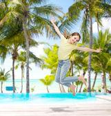 Smiling little girl jumping — Stock Photo