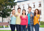 Group of smiling teenagers over campus background — Foto Stock