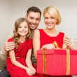 Happy family opening gift box — Stock Photo #54000141