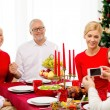 Smiling family having holiday dinner at home — Stock Photo