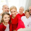 Smiling family making selfie at home — Stock Photo #54154067