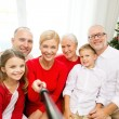 Smiling family making selfie at home — Stock Photo #54154111