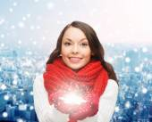 Smiling woman in winter clothes with snowflake — Stock Photo
