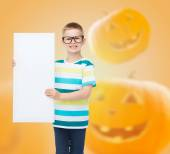 Smiling little boy with white board — Stock Photo