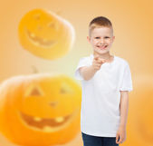 Smiling boy over pumpkins background — Stock Photo
