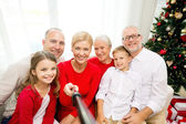 Smiling family making selfie at home — Stock Photo