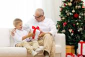 Smiling grandfather and grandson at home — Stock Photo