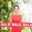 Smiling young woman in dress with red sale sign — Stok fotoğraf #54316127