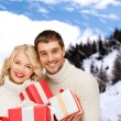 Smiling man and woman with presents — Stock Photo #54319129