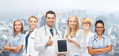 Team or group of doctors with tablet pc computer — Stock Photo