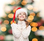 Dreaming girl in santa helper hat — Stock Photo