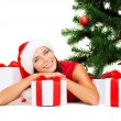 Smiling woman in santa helper hat with gift boxes — Stock Photo #54320017
