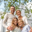Happy family in front of house outdoors — Stock Photo #54320399
