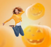 Smiling young woman jumping in air — Stock Photo