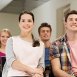 Group of smiling students in lecture hall — Stock Photo #54404191