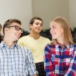 Group of smiling students in lecture hall — Stock Photo #54404359