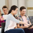 Group of smiling students with tablet pc — Stock Photo #54404615