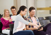 Group of smiling students with tablet pc — Foto de Stock