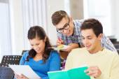 Group of smiling students with notebooks — Stock Photo