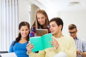 Group of smiling students with tablet pc — Stockfoto