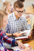 Group of smiling students with books — Stock Photo