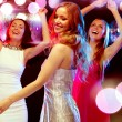 Three smiling women dancing in the club — Stock Photo #54503777