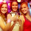 Three smiling women with champagne glasses — Stok fotoğraf #54504311