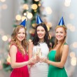 Smiling women holding glasses of sparkling wine — Stock Photo #54504543