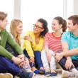 Five smiling teenagers having fun at home — Stock Photo #54506497