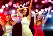 Three smiling women dancing in the club — Foto de Stock