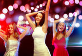 Three smiling women dancing in the club — ストック写真