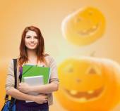 Smiling student girl with books and bag — Stock Photo