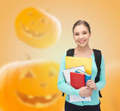 Smiling student girl with books and backpack — Stock Photo