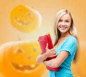 Smiling student girl with books and tablet bag — Stockfoto