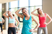 Group of women working out in gym — Stockfoto