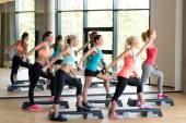 Group of women with dumbbells and steppers — Stok fotoğraf